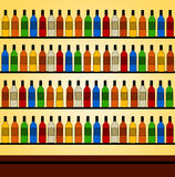 Bar. Different kinds of wines and liquors behind the bar counter Stock Image