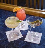 Bar Drinks. Three different bar drinks against blue bar background Stock Photography
