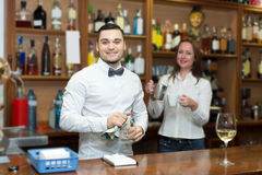 Bar employees serving clients Royalty Free Stock Photo