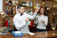 Bar employees serving clients Royalty Free Stock Photos