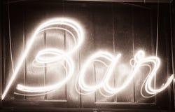 Bar entrance. Glowing  Bar  sign at night Stock Photo