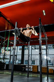 Bar exercises. workout in dark gym stock photos