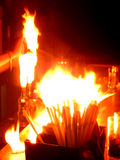 Bar on Fire. A bartender sets two alcohol bottles on fire as a trick in the pub Royalty Free Stock Photography