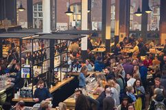Bar at the Food Hallen. Amsterdam, Netherlands - 21 November, 2015: View of the food hall at the De Hallen event hall on the Bellamyplein Stock Photo