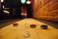 Bar games. Shuffleboard table in a cool Stock Photos