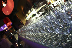 Bar and glasses. Row of glasses in a fancy bar stock photo