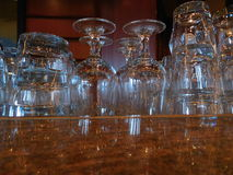 Bar Glasses. These bar glasses are cleaned and ready for the nights entertainment in a bar on a cruise ship Stock Images