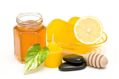 Bar of glycerin soap, jar of honey and lemon Stock Photography