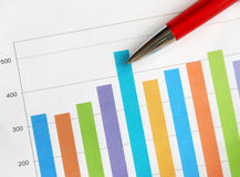 Bar graph. Colorful bar graph and red pen Stock Photo