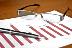 Bar graph data with glasses Royalty Free Stock Image