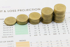 bar graph of Gold coins on paper business documents. Stock Photos