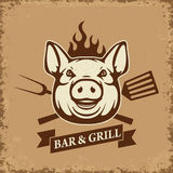 Bar and grill. Pig head with kitchen tools on grunge background. Royalty Free Stock Image
