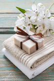 Bar of handmade natural soap lying on the towels Royalty Free Stock Images