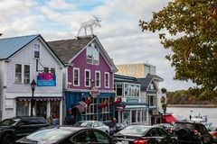 Bar Harbor downown with early afternoon lights. BAR HARBOR, MAINE, USA - OCTOBER 13, 2016: Bar Harbor downown with early afternoon lights during Autumn season stock photo