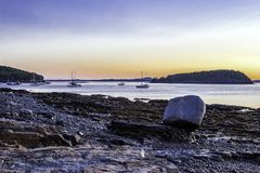 Bar Harbor Early Sunrise. Early sunrise on Bar Harbor Maine, with island and boats in the background stock photography