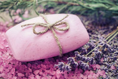 Bar of homemade soaps, sea salt and dry lavender flowers. Selective focus Stock Photos