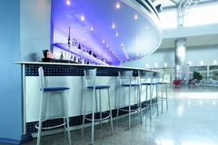 Bar interior. With round couter and stools Royalty Free Stock Images