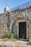 The belfry and the side door in the functioning church of the Christian Maronites in the abandoned village Kafr Birim in the north. Bar`am, Israel, June 09, 2018 stock photo