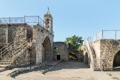 The fasade with the belfry of the functioning church of the Christian Maronites in the abandoned village Kafr Birim in the north o. Bar`am, Israel, June 09, 2018 royalty free stock image