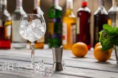 Bar jigger and wineglass. Stock Photo