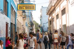 Bar La Bodeguita del medio, on Obispo street. Tourists walking i Stock Image