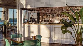 Bar Of Lebanese Restaurant Before Guests Arrive. Mackay, Queensland, Australia - 12th July 2019: Bar of empty Lebanese waterfront restaurant waiting for its royalty free stock image
