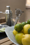 Bar Lemons and Limes. Photographs of a bowl of lemons and limes on a bar with bar equipment stock photography