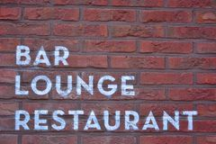 Bar, lounge, restaurant. Written on a wall in white lettering Stock Photo