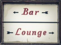 Bar And Lounge Sign. Grungy Vintage Bar Sign Outside A UK Pub Royalty Free Stock Images