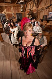 Bar Maid in Crowded Saloon royalty free stock images