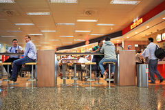 Bar at Malpensa airport in Milan, Italy. MILAN - SEP 21: Unidentified people sitting in restaurant at Malpensa International Airport - largest airport in Royalty Free Stock Photos