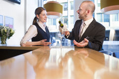Bar manager training a member of staff Royalty Free Stock Images