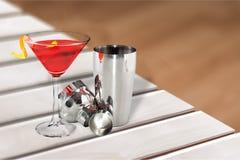 Metallic barman shaker with cocktail on bar royalty free stock photo