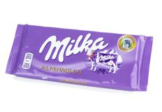 A bar of Milka Mondelez Alpenmilch milk chocolate Stock Photos