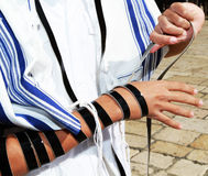 Bar mitzvah. Boy puts on tefillin in Jerusalem by the western wall stock photography