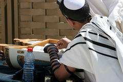 Bar Mitzvah. Young man reades from the Thora during his Bar Mitzvah at the Western Wall.Jerusalem,Israel royalty free stock image