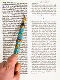 Bar Mitzvah Boy Practicing. A Bar Mitzvah boy practices reading the Torah in a tikkun, or book with modern Hebrew text on the right and the text as it appears Stock Image