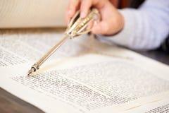 Bar Mitzvah torah reading. Yad pointing at text in torah Royalty Free Stock Images