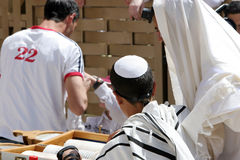 Bar Mitzvah At the Western Wall. Young mans Bar Mitzvah, reading the Torah,at the Western Wall, Jerusalem,Israel royalty free stock image