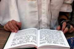 Bar Mitzwah book. Bar Mitzvah celebration ritual showing ceremonial reading from the Jewish religious book called Torah Stock Images