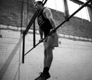 Bar muscle up workout - High intensity royalty free stock image