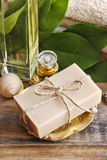 Bar of natural handmade soap and bottle of essential oil Stock Photos