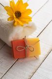 Bar of natural handmade soap and towel on table Stock Photos