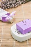 Bar of natural lavandah soap on white soap dish Royalty Free Stock Photos