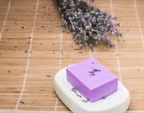 Bar of natural lavandah soap on white soap dish Stock Photo
