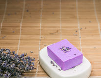 Bar of natural lavandah soap on white soap dish Stock Image