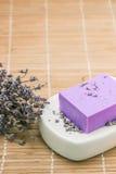 Bar of natural lavandah soap on white soap dish Stock Images