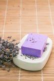 Bar of natural lavandah soap on white soap dish Stock Photography