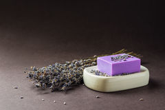 Bar of natural lavender soap on white ceramic soap dish Royalty Free Stock Photo