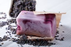 Bar of natural organic soap with lavender on white wooden background. Handmade soap making. Spa products and skin care concept stock photo